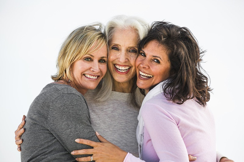 Three elderly woman hugging