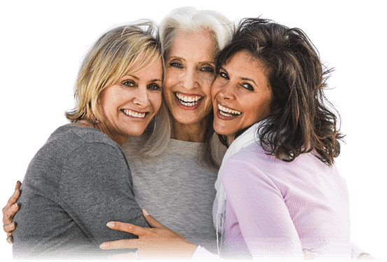 Three mature woman in a group hug